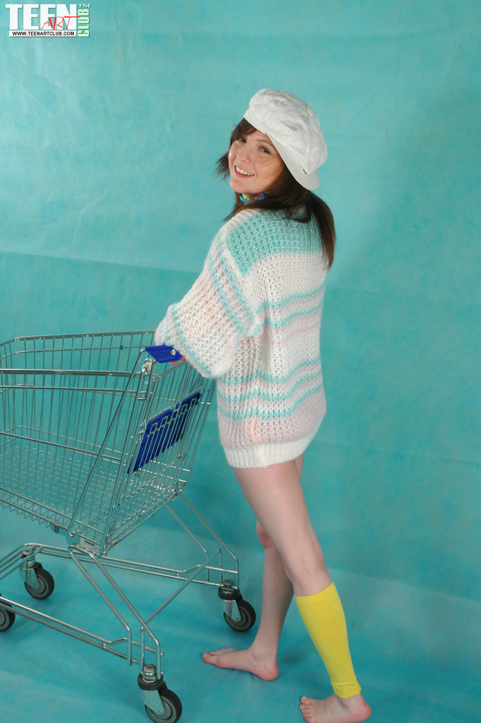 Sexy Brunette Shop Assistant Playing In a Shopping Cart in Fully Naked Pose
