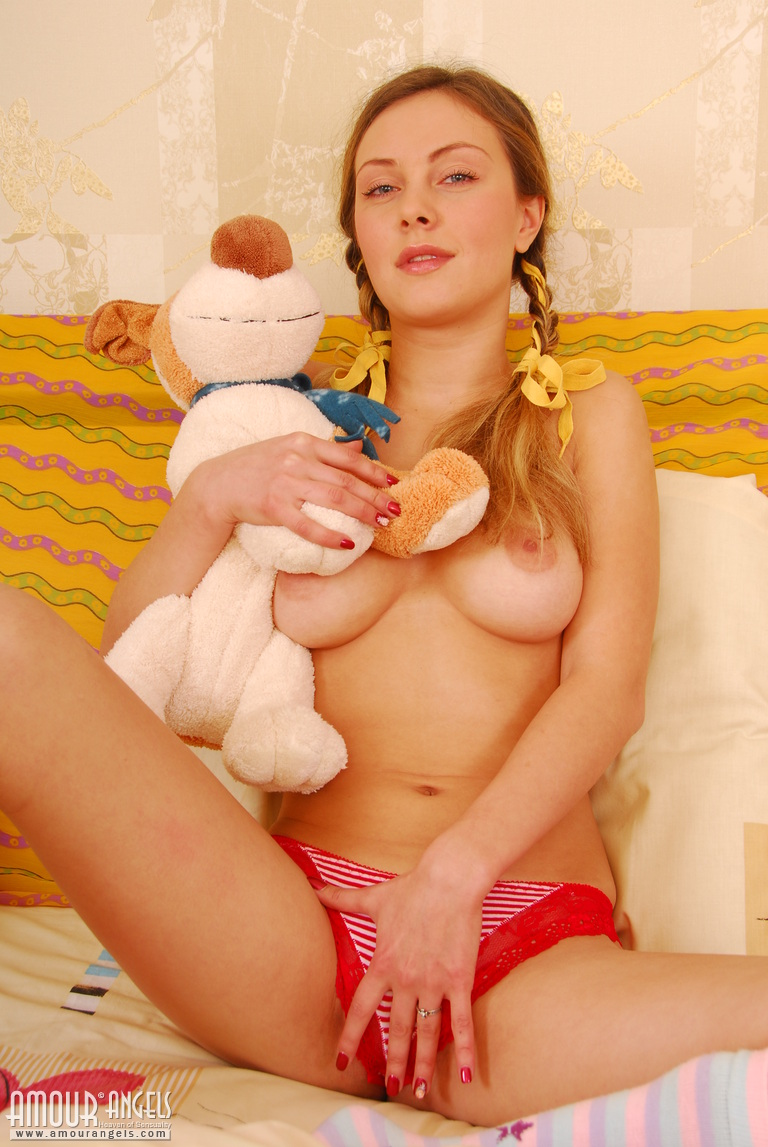 Golden Haired Pigtail Teen Beauty Playing With Her Teddy Beer