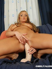 Blonde Chick Full Riding Action on the White Long Dildo Her Shaved Pussy