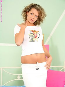 Curly Haired Buxom Vanesa in White Costume Flashing Her Pair of Tits and Twat