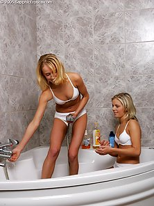 Blonde Haired Young Babes Rene and Hanna Wet Their Body in Bathroom