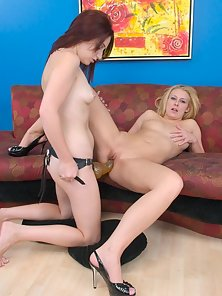 Stunning Blonde Babe Gets Fucked Hard By a Long Strap On With Her Friend