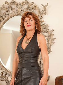 Naughty Anilos Cascade Teases in Black Leather Mini Dress on Couch