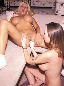 Big Tits Brunette Babe Riding a Machine Dildo with Her Lesbian Partner
