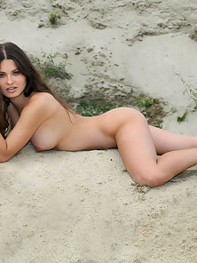 Nude Brunette Lesbian Babe Sleeping On The Sand