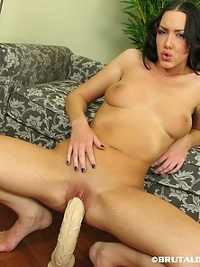 Audrey stuffs her pussy with a dildo