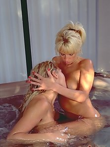 Stunning blonde dykes get it on in a hot tub