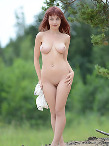 Red Headed Chick Show Her Standing Alone Under the Tree