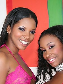 Two Ebony Lesbians Sharing a Glass Dildo after Licking Black Slits