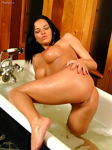 Big Breasted Brunette Chick Lanny Braby Making Masturbating Action in Bathroom