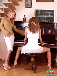 Two splendid blonde lesbians licking their pink quims on a piano