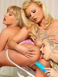 Threesome Naughty Lesbian Girls Posing Their Massive Boobs and Playing With a Dildo