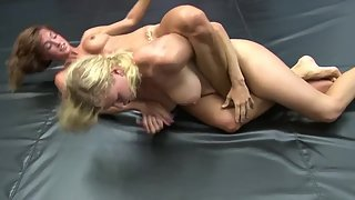 Wild ladies wrestling and rubbing each others pussy