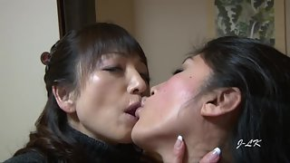 Japanese girls are making out right before shoving fingers in each other's slits