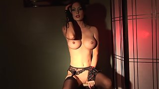 Kinky milf in black lingerie masturbating alone